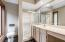 • Granite flooring • Tan painted walls • Can lighting • Enclosed vanity with single bowl, cultured marble sinktop • Lighted ceiling exhaust • Shower stall with glass doors