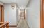 • Light sand carpet • Ivory painted walls • Hall laundry chute • Rear staircase