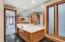 • Granite flooring • Tan painted walls • Whirlpool® tub with cultured marble surround • Mirrored walls • Enclosed vanity with double bowl, cultured marble sinktops • Ceiling exhaust • Shower stall with glass doors • Linen closet