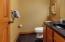 • Granite flooring • Tan painted walls • Ceiling exhaust • Enclosed vanity with single bowl, cultured marble sinktop • Studio lighting strip