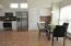 ceramic tile flooring, brushed nickel light fixture