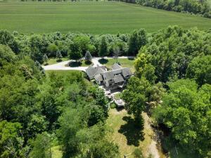 This Exceptional Estate Is An Unprecedented Opportunity To Own 20 + Acres Of Pristine Wooded Seclusion. The Meticulously Built Home Is Overlooking Wooded Terrain W/Duncan Run Flowing From Hoover Reservoir Throughout Property. Lavish Landscaping, TWO 40x40 Outbuildings W/3 Finished Offices & A Guest Apartment It Truly Offers The Ultimate Blend Of Work/Life Living As Well As Privacy & Nature! Main Home Over 3,980 SqFt W/Picturesque Views, Stone/Paver Terraces, Layers Of Decking, A True Professional Chef's Kitchen & A First Floor Owner's Suite! 3 Finished Floors Of Living Abound W/ Comfortable Indoor & Outdoor Entertaining Space! A Newly Renovated Walk Out LL W/Bar, Billiards Area, Bath, Office/Bedroom & Ample Storage! Riding Trails, Streams, Hiking & Hunting. A Sportsman's Paradise!