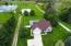 Beautiful properties are adjacent on each side of the 2 acre parcel