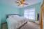 Bedroom #2 with double closet and ceiling fan