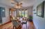 Custom teak flooring with ceiling fan and custom window treatments makes this a wonderful dining area