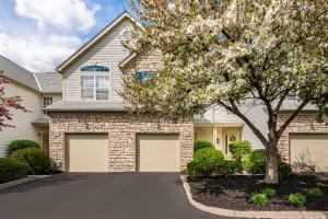 Beautiful stone garage front of house