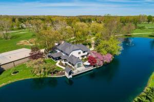 Spectacular 2 Acre Stocked Pond Surrounds The Home So Almost Every Room Has A Pond View!