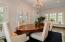 Beautiful dining room with original hand painted tile flooring. Two walls of windows + 3 sets of French doors that open to covered patio. Wonderful entertaining space.