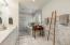 Marble heated flooring, marble double sink vanity, marble wet room with shower and soaking tub.
