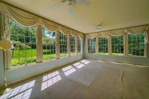 Family room with 9' ceiling and 2 walls of Windows overlooking 1/2 acre lot!