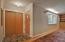 Slate tile with double door coat closet
