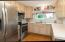 Stainless steel appliances remain with the home.