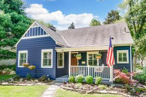Spacious Saltbox style Cape Cod features over 2000 sqft of impeccable living space in an ideal Clintonville location!