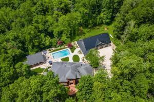 Private Country Estate within 15 Min To Downtown Powell & Dublin.  Custom Home Completely Remodeled. Very Deep Setback Off Hyatts Rd Surrounded With Deep Woods To The Rear Of The Lot.  Paved Driveway ( 2020 ) with Iron Gate.  40 X 68 Pole Barn For Cars, Boats, RV, Toys, Or Your Own Gym.  Guest/ Pool House with Bedroom / Full Bath and Kitchen.  The Florida Room Leads To A Great Outdoor Living Area..  Completely Remodeled Kitchen with Thermador & Meile Appliances ( Extended Warranty ) Professional Grade Appliances & ''Messy Kitchen'' Pantry.  ''European Spa Shower'' in Master Bath..... See List Of Improvements In ''Documents'' Section.  Survey Available Upon Request.  Appraisal Available Upon Request .....          OPEN SUNDAY 8/15  1:00-4:00