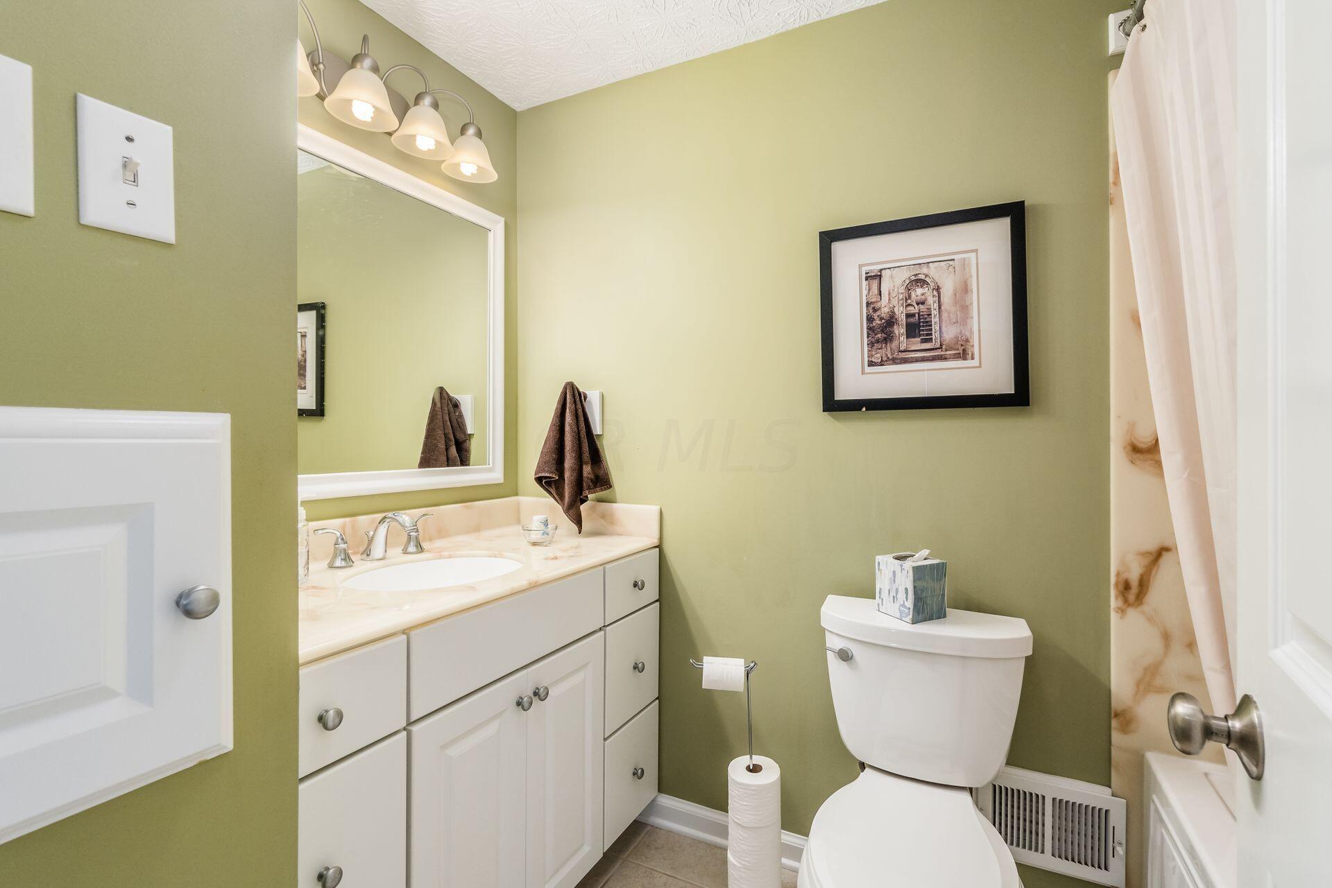 Full Bathroom with Laundry Shoot
