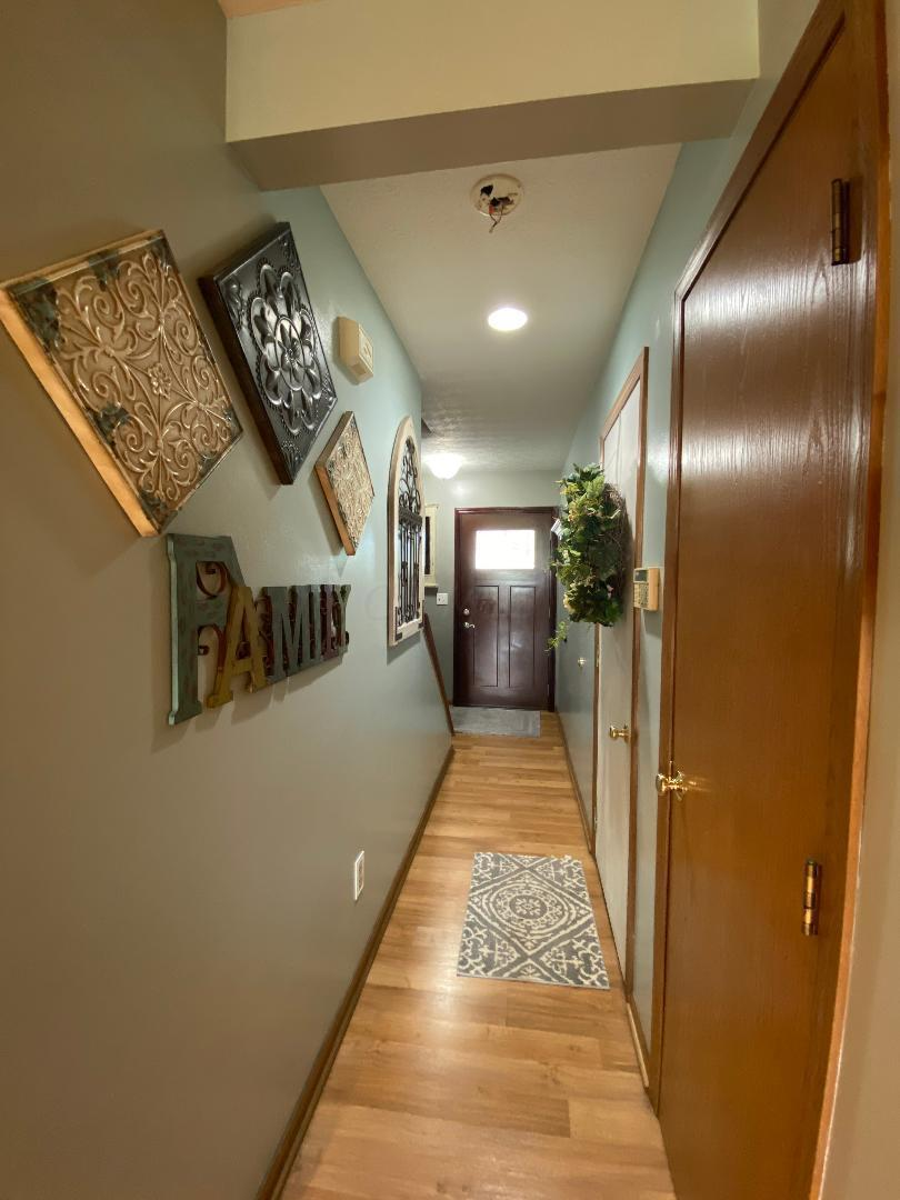hallway from formal LR into kitchen