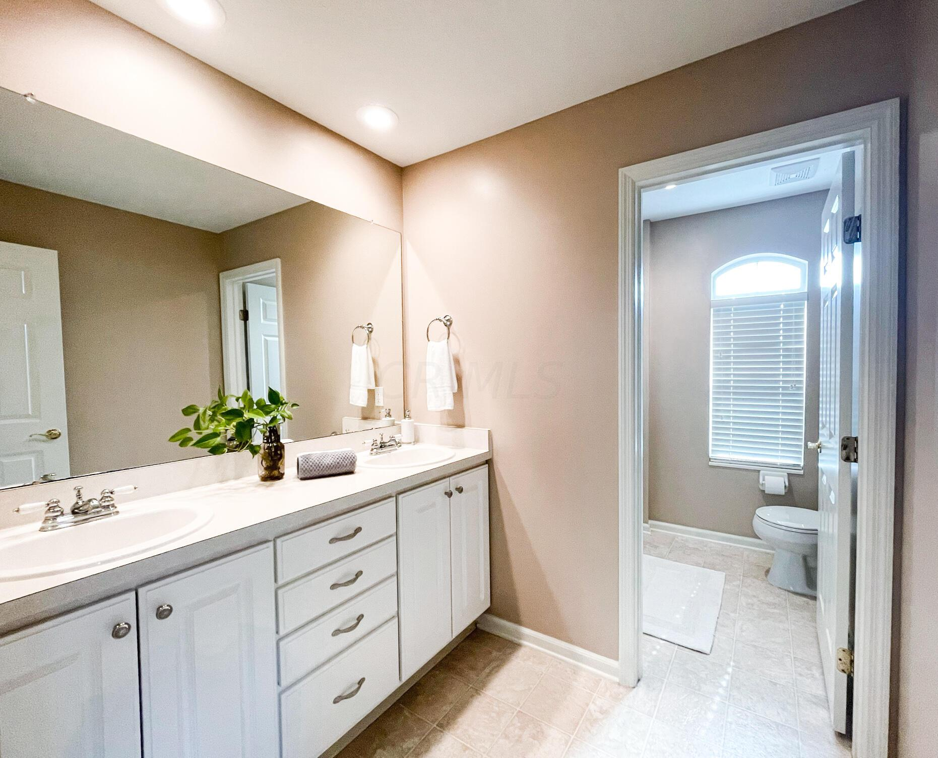 His & Hers Sinks in the En Suite Bath