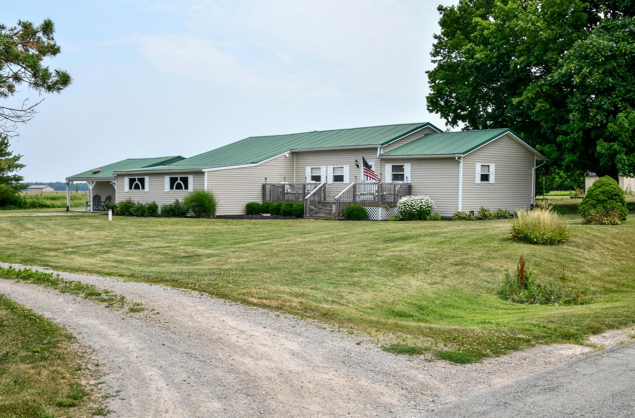 Drive Runs Between Home and Outbuildings