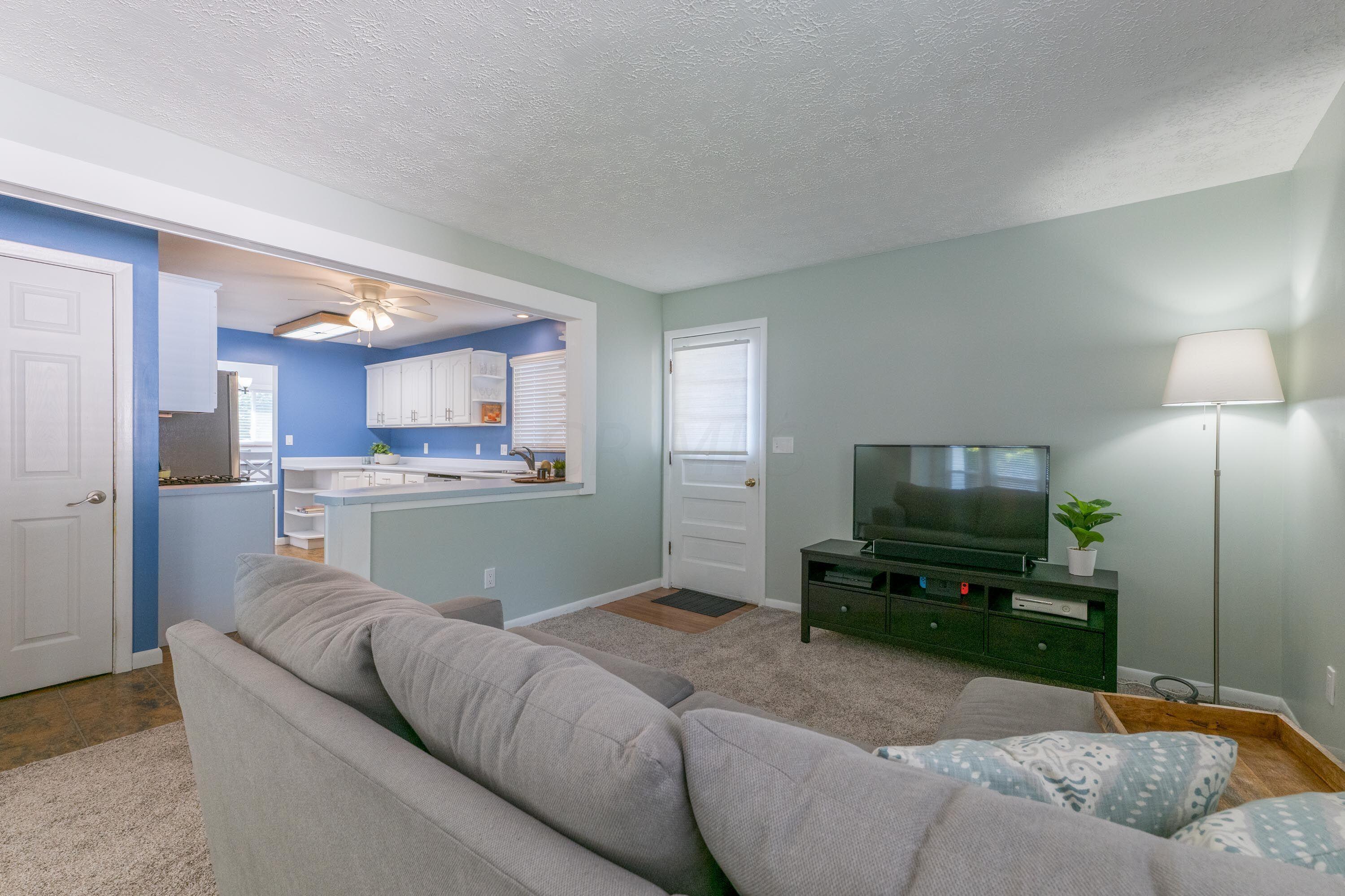 Family room has carpet, side door