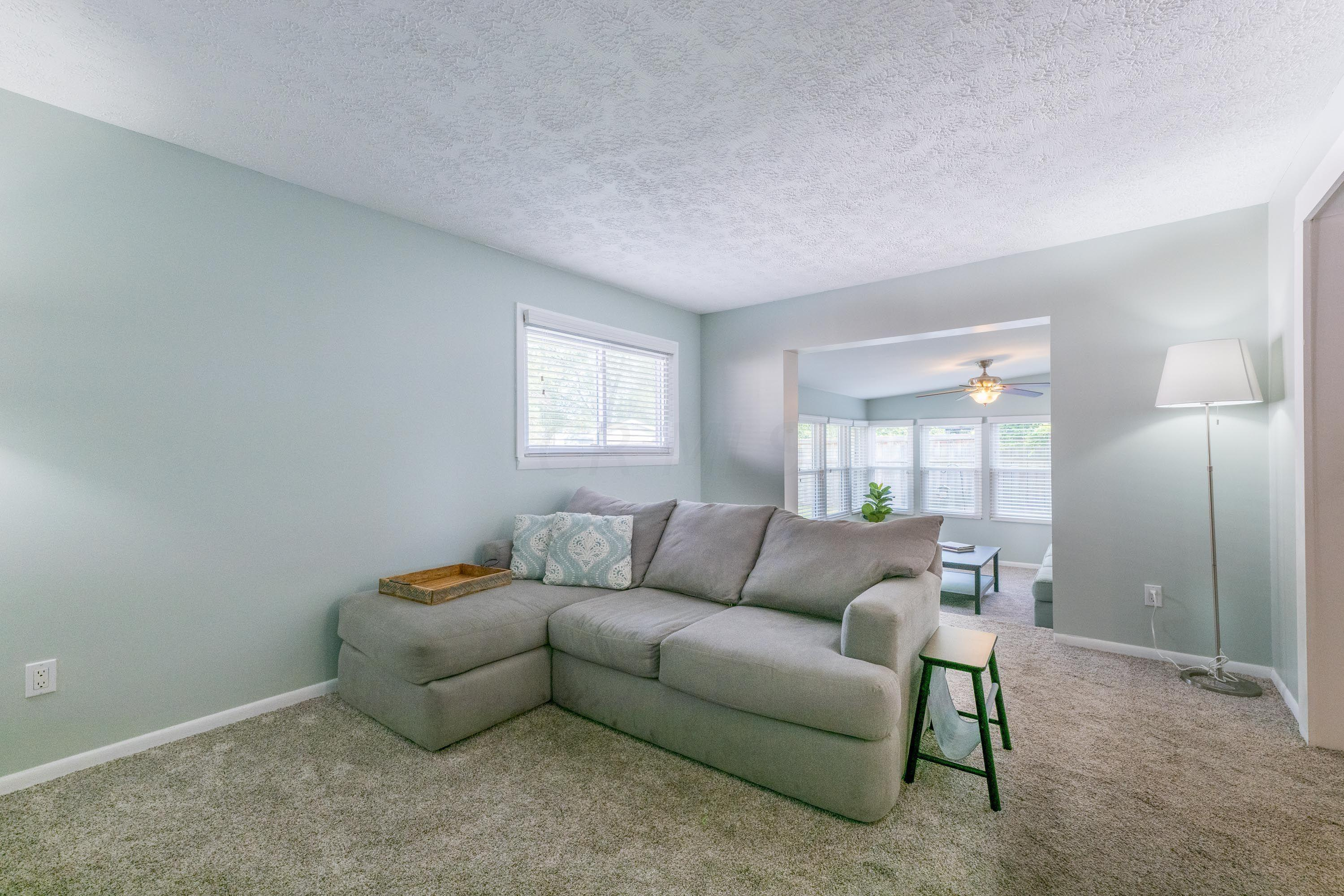 Family room opens to the sunroom
