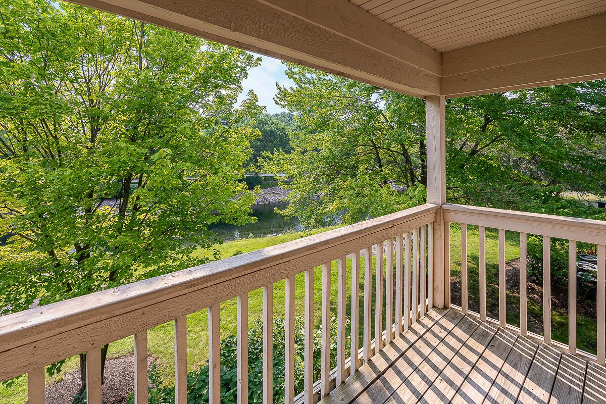 Covered balcony overlooking pond