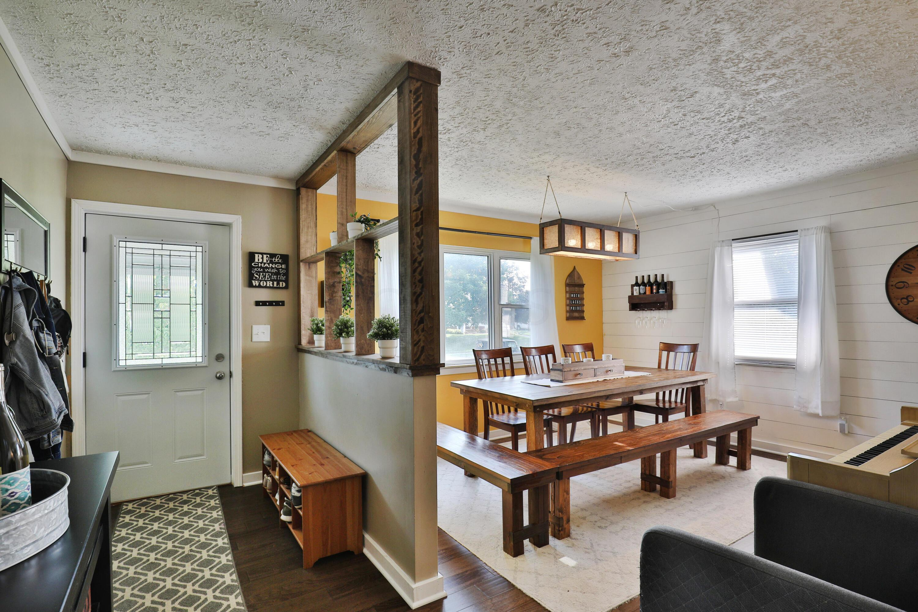 Dining room with shiplap wall feature