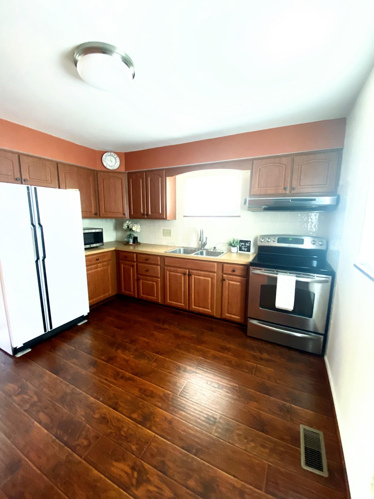 Kitchen with updated cabinets and floors