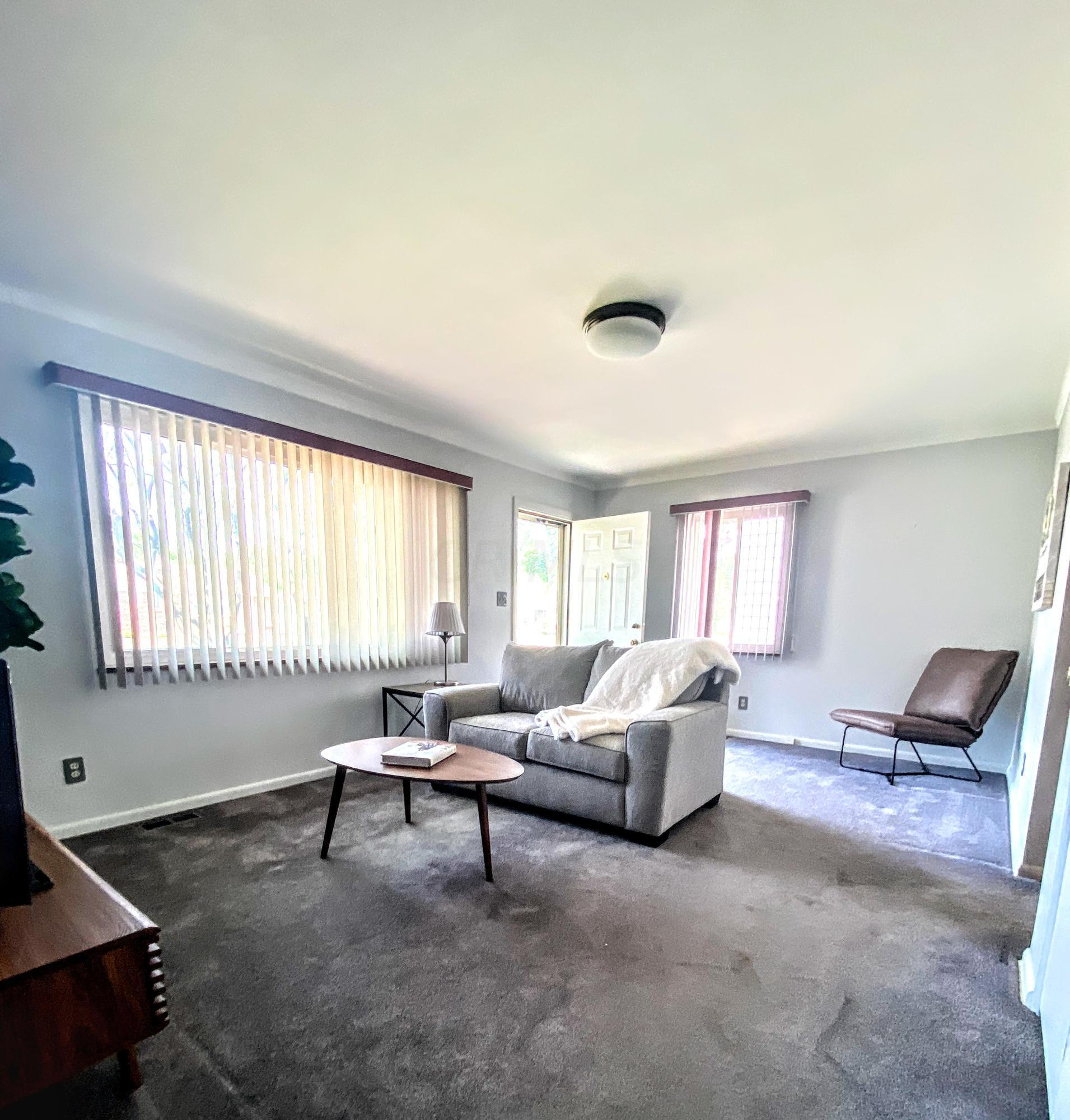Bright family room with large window