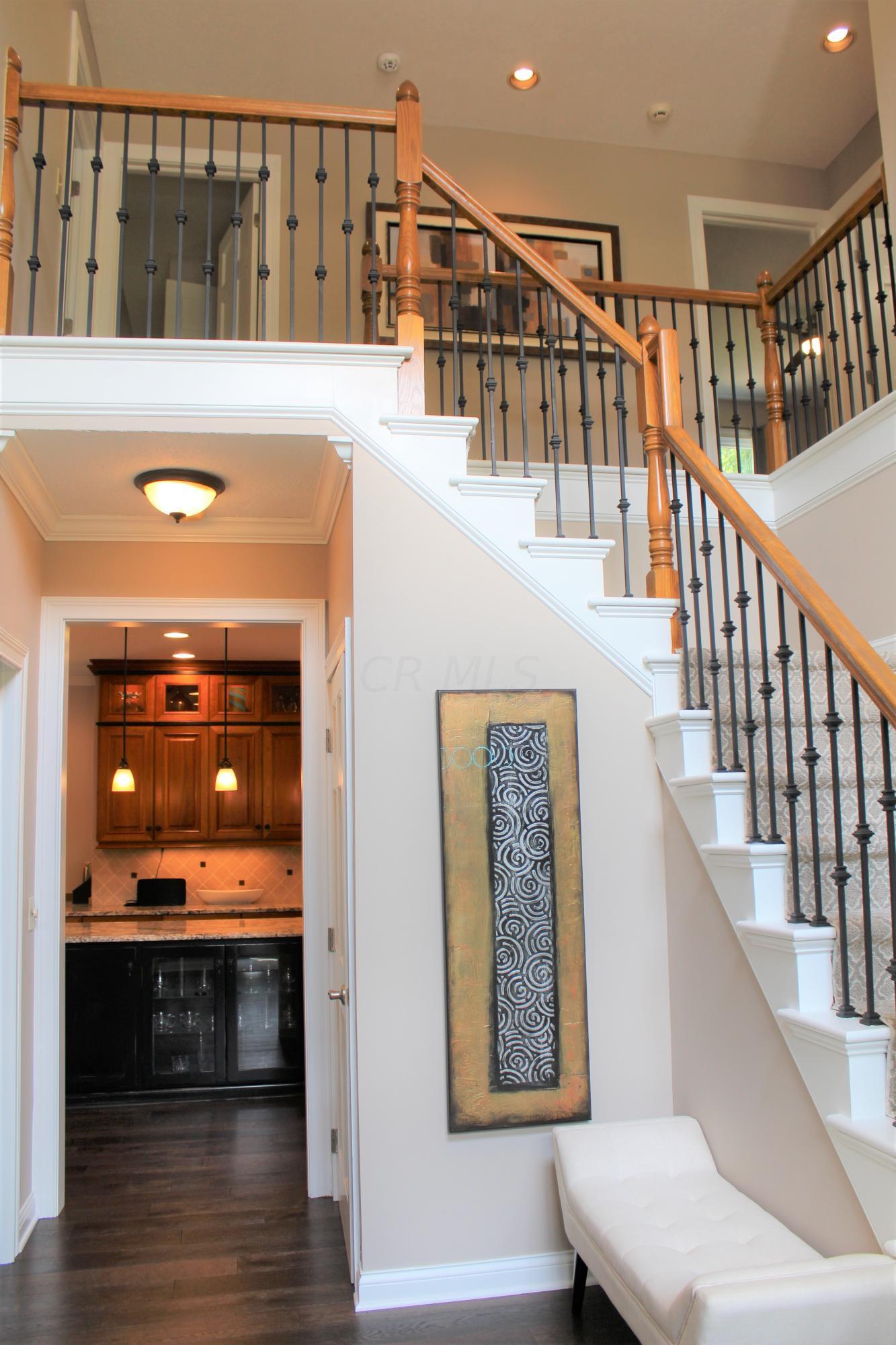 Foyer view to kitchen & Upper level