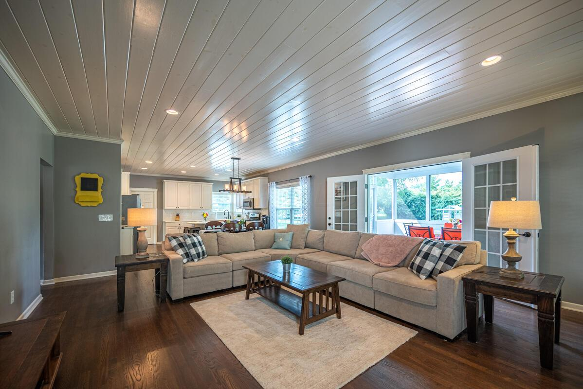 Great room opening to screened porch