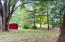 Spacious trees backyard includes shed
