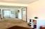 Lower living area w half bath and garage access