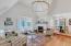 Spacious family room, original hardwood floors, gas fireplace, high end chandelier