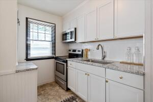 New Kitchen cabinets, large single basin sink, granite counters and stainless appliances