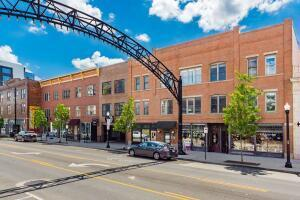 AMAZING LOCATION!  Right in the heart of the Short North, this industrial condo is in a secured building with an off street parking space!  Does it get any better than that?  Completely open floor plan with 2 large bedrooms, polished cement floors, 14' ceilings, quartz countertops and subway tile.  See the famous arches from your windows!