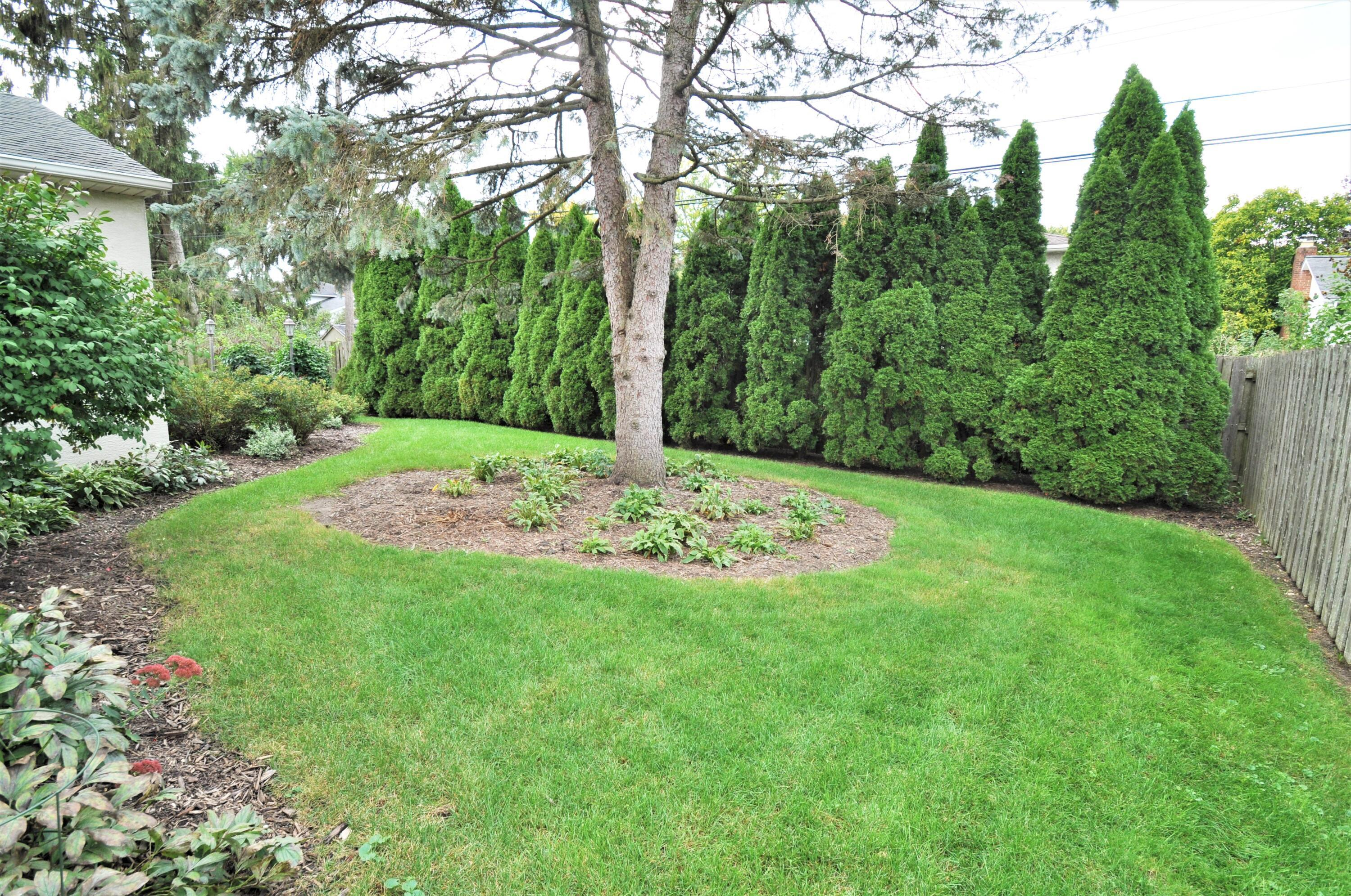 Lushly landscaped backyard with privacy!