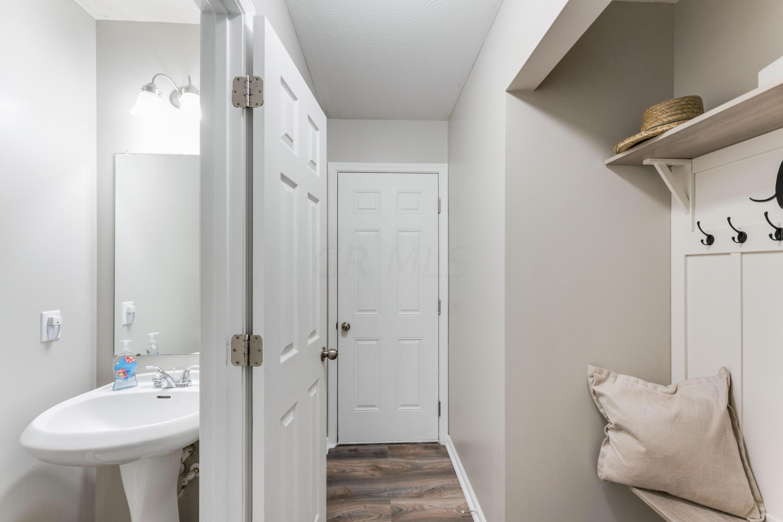 Entryway/ Half Bath/ Hallway