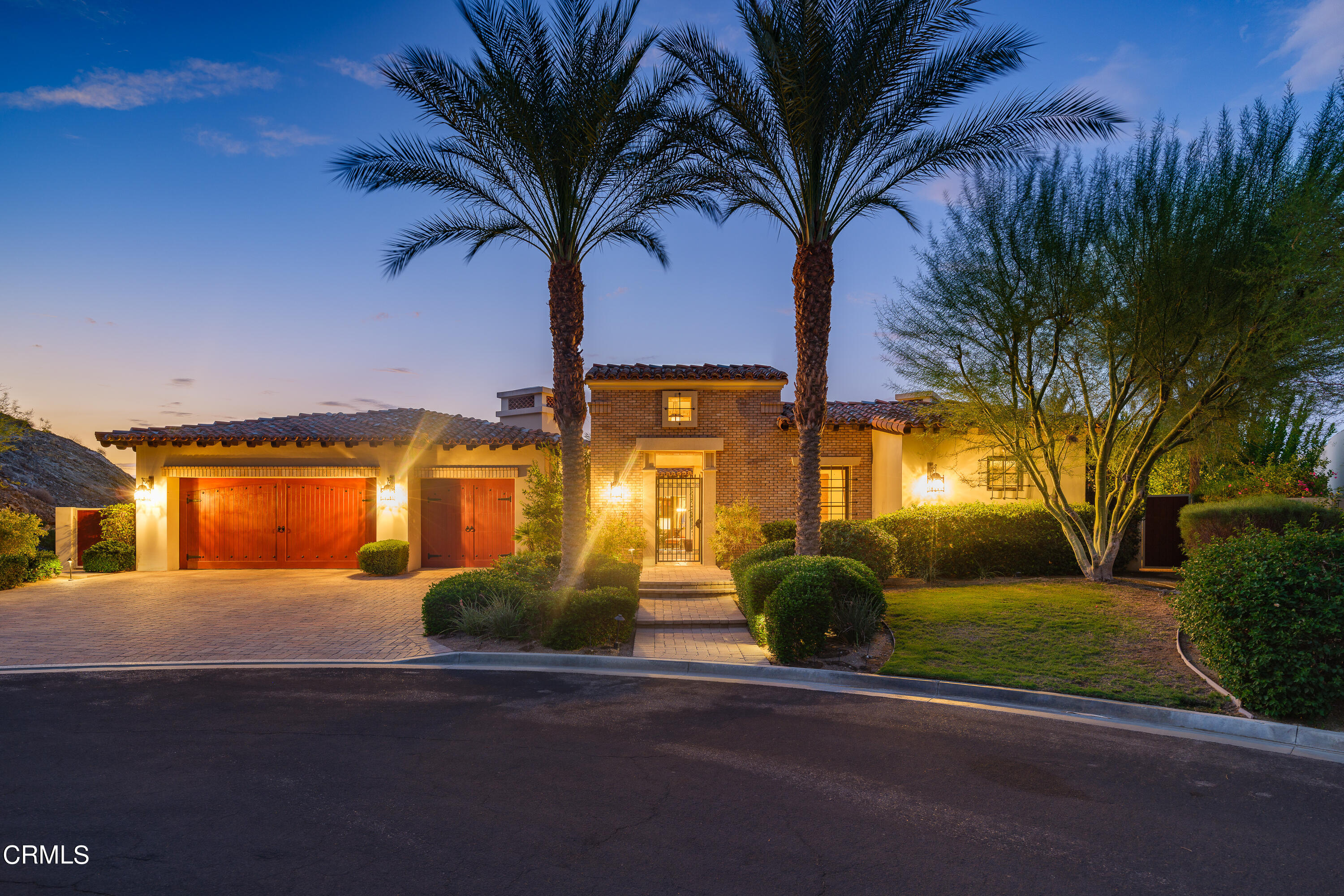 Designed & built with the finest finishes & amenities intended for luxury desert living is this 5 bedroom, 6 bathroom, 6,200 sq ft home in the Mirada Estates gated community in Rancho Mirage. Passing through the front gate, one is struck by the entryway that leads to the casita in front of the home which features a living room, a kitchenette area, a bedroom, & a bathroom. Past the casita is the courtyard that welcomes you with an outdoor fireplace, mini palm trees, vegetation, & a fountain. Passing through the front door, one is awed by the entryway that has stone tile flooring, beamed ceilings, base molding, & a chandelier. The home office has carpet floors, wood beam ceilings, recessed lighting, built-in cabinets, a fireplace, & a door to the courtyard. Entering into the living room one will notice the high vaulted ceilings with wood beams, the wall of glass on both sides of the room, highlighting both the courtyard & the backyard, a grand fireplace, a ceiling fan & opens up to the wet bar & the kitchen. The chef's kitchen showcases granite countertops with a stone tile backsplash, an oversized island with granite countertops & a double-sink, beautiful oversized cabinets with display shelves, pull-out drawers, recessed lighting, an additional sink, a door that leads to the backyard, stainless steel appliances and an eat-in area. The dining room has vaulted wood beamed ceilings, doors to the courtyard, & two built-in display cabinets. The wine room is capable of holding hundreds of wine bottles. On the West end of the home is the home theater, the  laundry room, the home gym, the three car garage, & three additional bedrooms. On the East side of the home is the primary bedroom suite & primary en suite bathroom. The primary bedroom features vaulted wood beamed ceilings, carpet floors, a fireplace, a walk-in closet, & doors that lead to the backyard. The en suite bathroom has a walk-in closet, a toilet room, a separate toilet/bidet room, double sinks with a vanity de