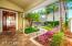 Lush tropical surroundings greet you at the front door