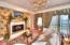 Private sitting area with fireplace adjoins owners suite.