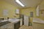 LAUNDRY ROOM WITH MAYTAG WASHER & DRYER & CONVENIENT LAUNDRY TUB