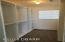 Walk in closet with built ins in lower level master