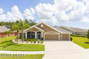 1600 Areca Palm custom Windsor floor plan 4/3 with oversized 3 car garage.