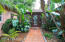 Stone walkway leads to elegant glass door entry.