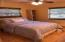 Bedroom 3 has warm wood floors, tons of space and light streaming in from 2 windows.
