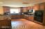 Kitchen features custom cabinets with upper and lower crown molding that adds the extra touch.