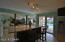 SPACIOUS LIVING SPACE THAT COMBINES KITCHEN WITH CASUAL DINING ISLAND FLOWING INTO LIVING ROOM AND OUTSIDE COVERED LANAI AND POOL.