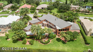 Located in the Spruce Creek Fly-In, this unique estate offers many features and amenities to its homeowner.