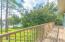 Upstairs Balcony with Beautiful View of the sprawling Backyard to Lake Mamie