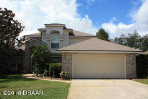 3 bedroom 2.5 bath pool home with lush landscaping